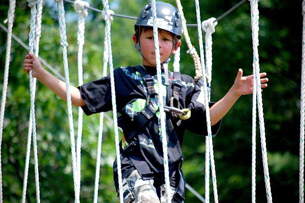 kid walking through rope bridge