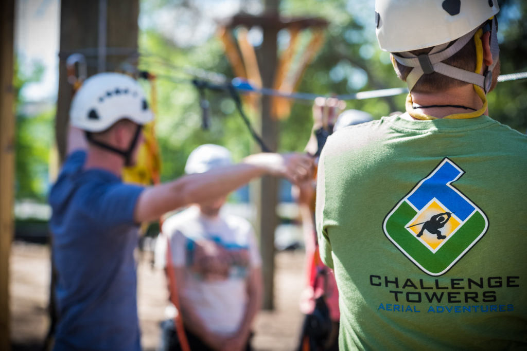 Man wearing a Challenge Towers t-shirt.
