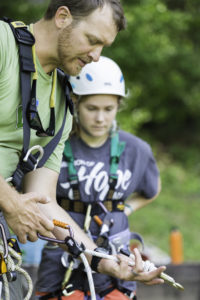 Trainer explaining how a belay system works.