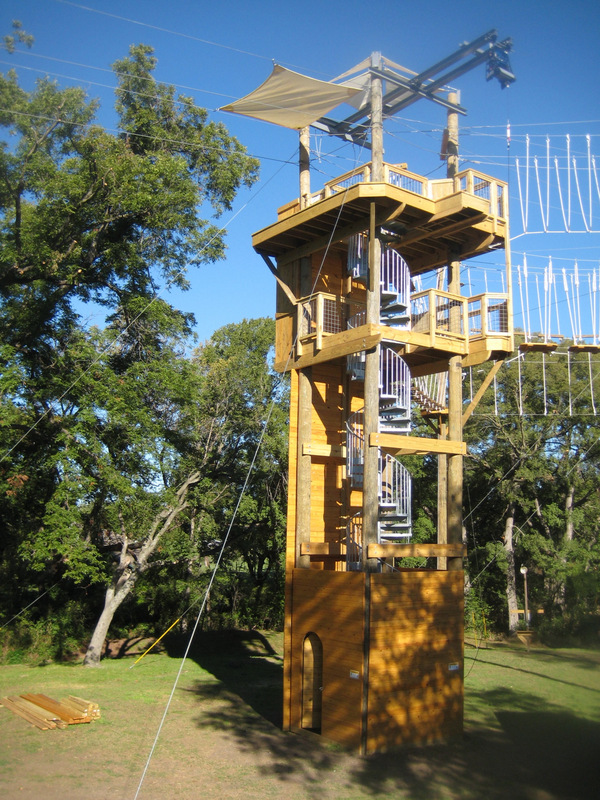 Challenge course tower with winding staircase.