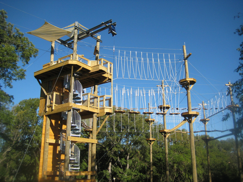 Challenge course tower with extended rope features.