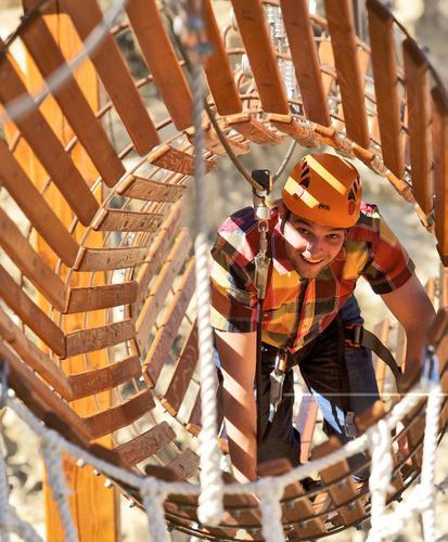 Man crawling through a barrel tunnel.