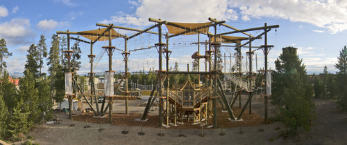 Challenge course with rope features wide view.