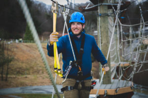Man on adventure course.