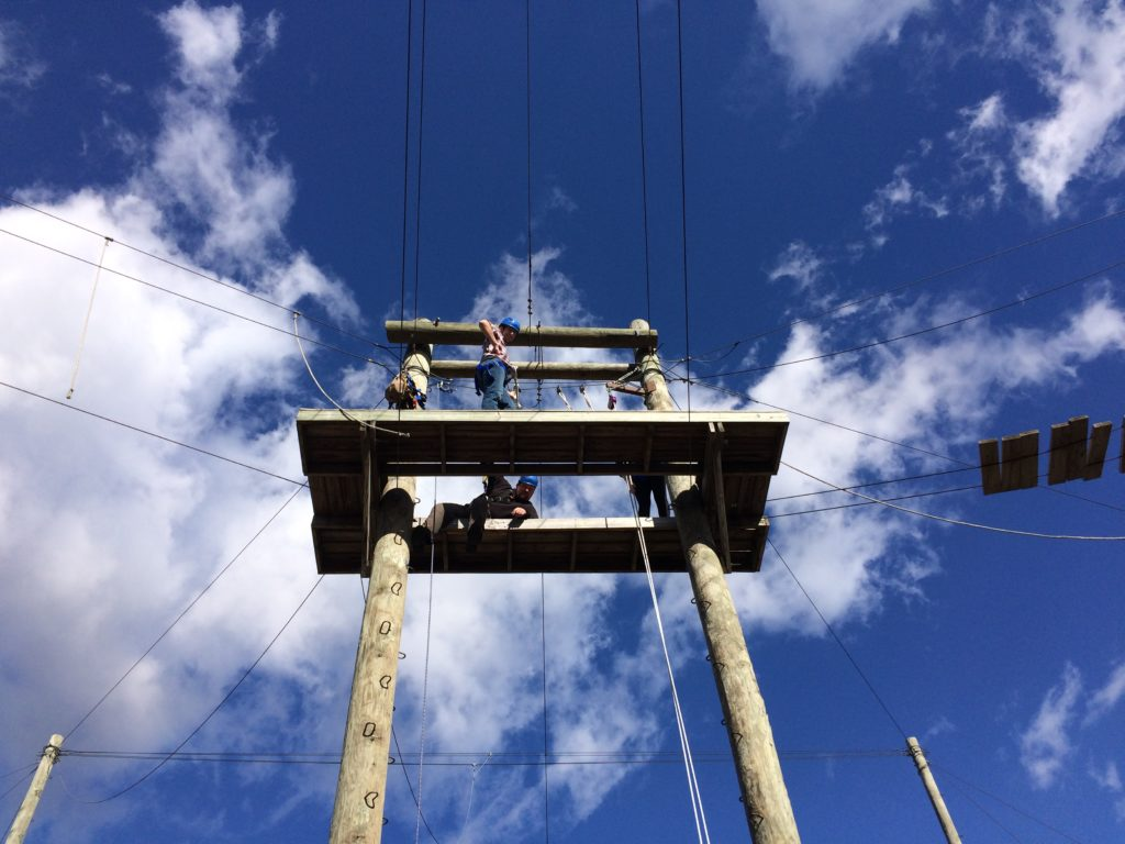 high-ropes-challenge-course-below-platform-blue-skies