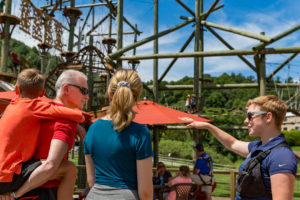 Aerial Park operator showing a family of guests around the aerial park