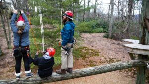 Trainer and Trainees at height in ropes course - rescue lower